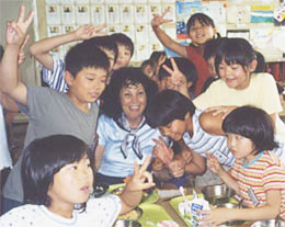 Gail having fun with students in Japan